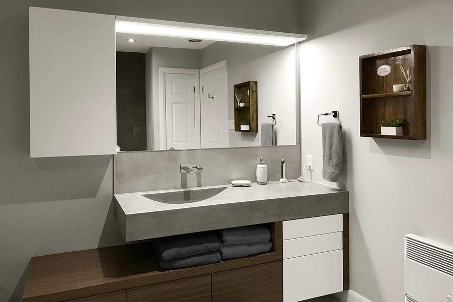 Vanité avec comptoir-lavabo en béton